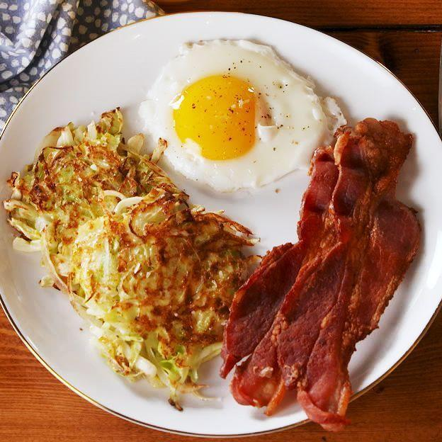 """<p>I know it might be hard to believe, but these <a href=""""https://www.delish.com/uk/cooking/recipes/a30313001/cauliflower-hash-brown-egg-cups/"""" rel=""""nofollow noopener"""" target=""""_blank"""" data-ylk=""""slk:hash browns"""" class=""""link rapid-noclick-resp"""">hash browns</a> really taste like they're made with potatoes! The onions aren't necessary, but we love them! What CAN'T cabbage do?!</p><p>Get the <a href=""""https://www.delish.com/uk/cooking/recipes/a30698271/cabbage-hash-browns-recipe/"""" rel=""""nofollow noopener"""" target=""""_blank"""" data-ylk=""""slk:Cabbage Hash Browns"""" class=""""link rapid-noclick-resp"""">Cabbage Hash Browns</a> recipe.</p>"""