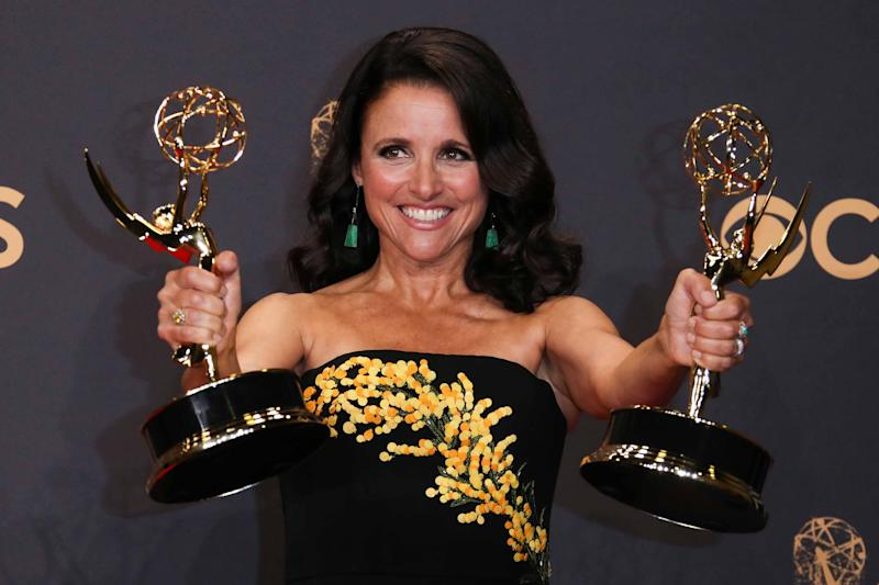 Julia Louis-Dreyfus, seen here holding outstanding-actress and comedy-series Emmys for