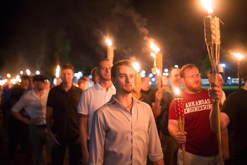 "White supremacists march with tiki torches through the University of Virginia campus the night before the ""Unite the Right"" rally in Charlottesville. (Zach D Roberts/NurPhoto via Getty Images)"