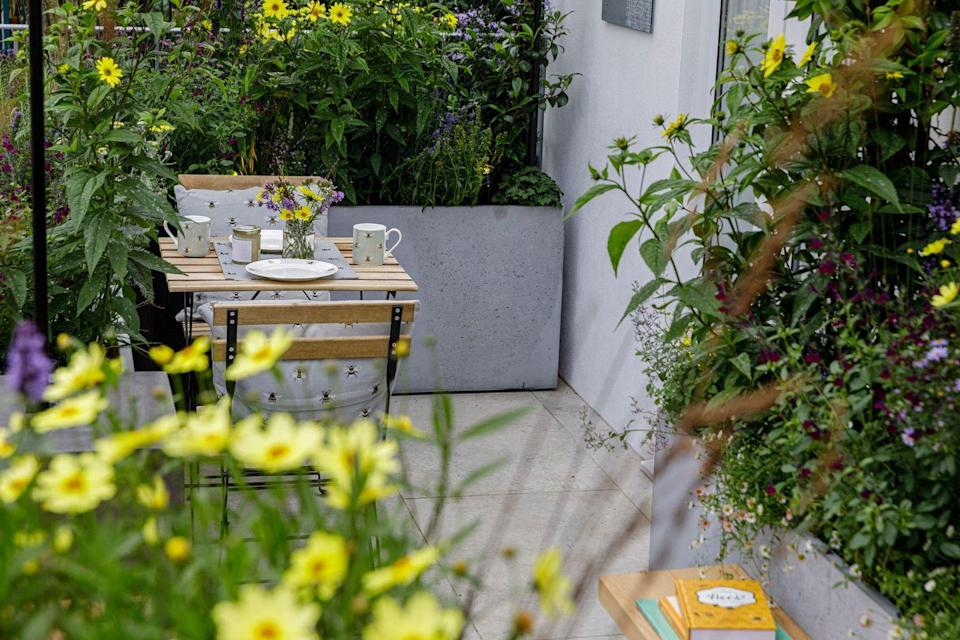 """<p>The Landform Balcony Garden at the <a href=""""https://www.countryliving.com/uk/news/a34460466/chelsea-flower-show-2021/"""" rel=""""nofollow noopener"""" target=""""_blank"""" data-ylk=""""slk:RHS Chelsea Flower Show 2021"""" class=""""link rapid-noclick-resp"""">RHS Chelsea Flower Show 2021</a>, designed by Nicola Hale, is a celebration of how small urban spaces can be transformed into valuable wildlife havens. Some of the key features include vibrant <a href=""""https://www.countryliving.com/uk/wildlife/countryside/a28468662/sunflower-fields-visit-uk/"""" rel=""""nofollow noopener"""" target=""""_blank"""" data-ylk=""""slk:sunflowers"""" class=""""link rapid-noclick-resp"""">sunflowers</a>, salvias, asters, sculptural specimen shrubs and a bistro table for alfresco dining. </p><p>""""I have used lots of sunflowers partly because they are my favourite cut flower as well as being great for bees and, later in the season, the sunflower seeds are a magnet for birds,"""" Nicola says. """"They are bright, sunny and whether they are tall or short, large, or small, bright or subtle and they always make me smile!""""</p><p><strong>READ MORE</strong>: <a href=""""https://www.countryliving.com/uk/homes-interiors/gardens/a37630203/the-landform-balcony-garden-chelsea-flower-show-2021/"""" rel=""""nofollow noopener"""" target=""""_blank"""" data-ylk=""""slk:The Landform Balcony Garden at Chelsea Flower Show 2021: Inside the beautiful bee-friendly space"""" class=""""link rapid-noclick-resp"""">The Landform Balcony Garden at Chelsea Flower Show 2021: Inside the beautiful bee-friendly space</a></p>"""