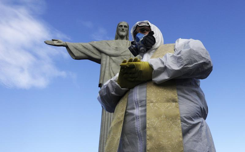 Catholic Priest Omar is pictured as Military members work on disinfection of the Christ the Redeemer statue ahead of its re-opening amid the coronavirus disease (COVID-19) outbreak, in Rio de Janeiro, Brazil, August 13, 2020. REUTERS/Ricardo Moraes TPX IMAGES OF THE DAY