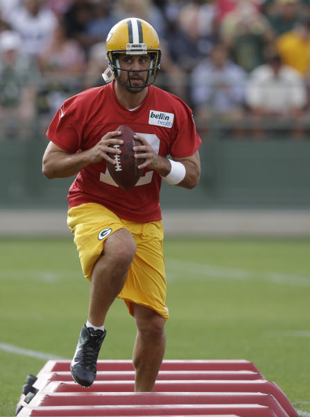 Green Bay Packers' Aaron Rodgers runs a drill during NFL football training camp Friday, July 26, 2013, in Green Bay, Wis. (AP Photo/Morry Gash)