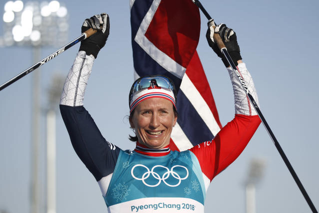 Norway's Marit Bjorgen celebrates her 8th career gold medal win in the ladies 30km mass start in PyeoncgChang. (Getty Images)