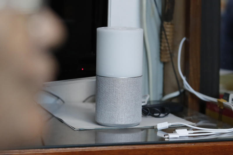 """SK Telecom's AI speaker Nugu built with an artificial intelligence called """"Aria"""" and a lamp that turns blue when processing voice commands for news, music and internet searches, is seen at a senior citizen's home in Seoul, South Korea, on May 13, 2020. The devices can also use quizzes to monitor the memory and cognitive functions of their elderly users, which would be potentially useful for advising treatments. (AP Photo/Lee Jin-man)"""
