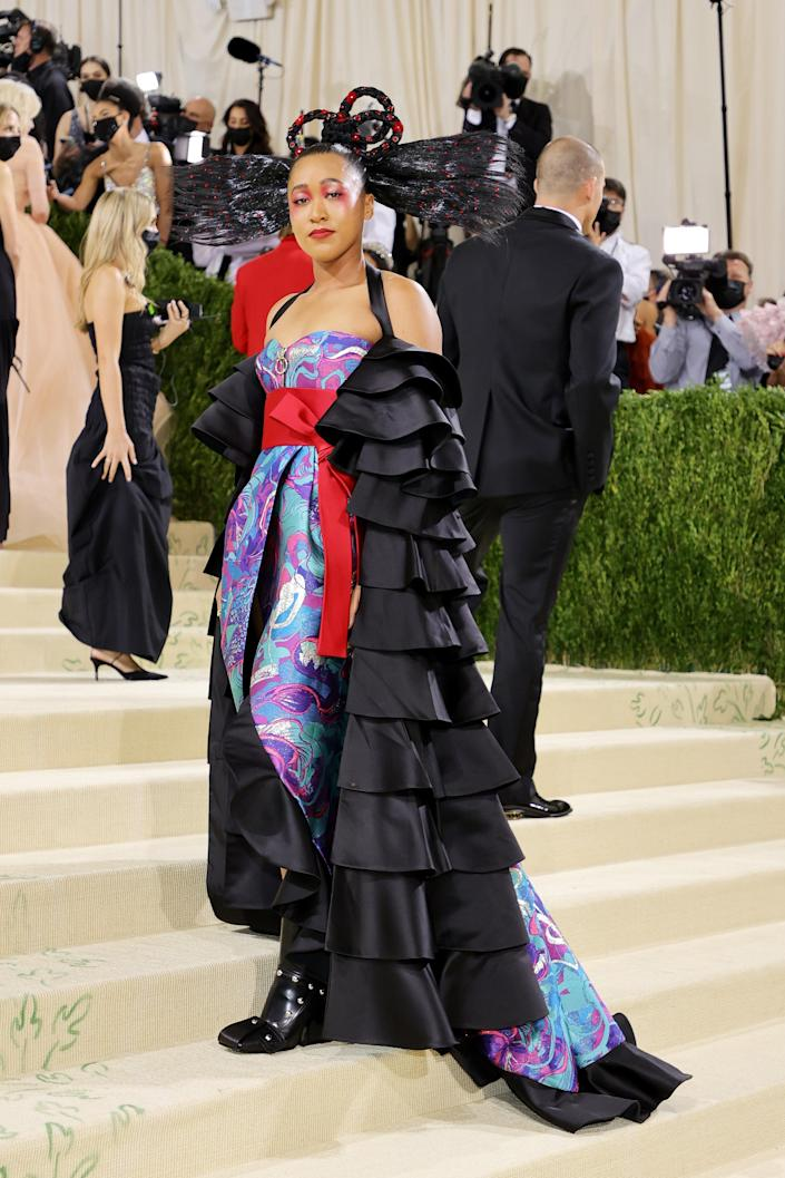 <h2>Naomi Osaka wearing Louis Vuitton</h2><br>Co-chair and four-time Grand Slam winner Naomi Osaka allowed her older sister the opportunity to collaborate with Louis Vuitton designer Nicolas Ghesquière to create her Met Gala look, which combined her Haitian and Japanese heritage.