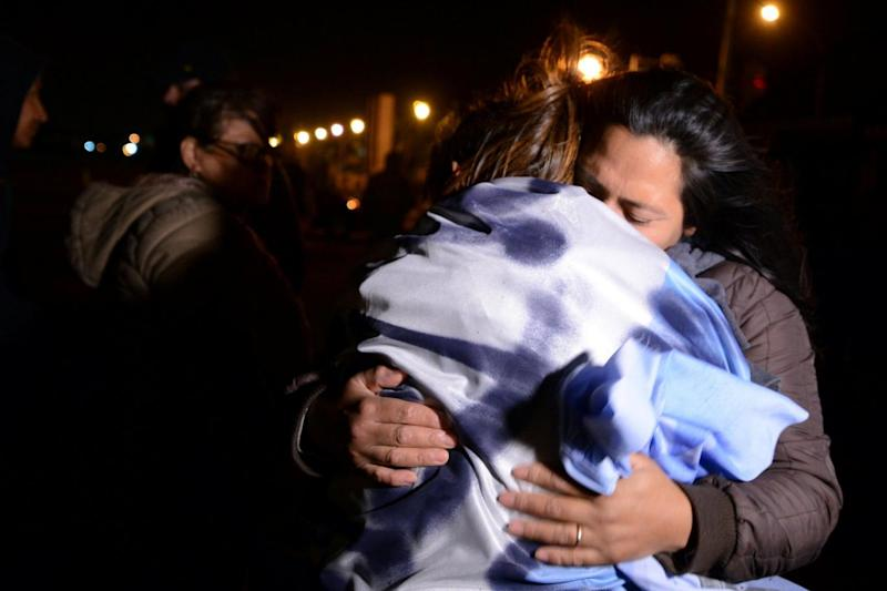 Relatives of the 44 crew members of the missing at sea ARA San Juan submarine react outside the Argentine Naval Base (REUTERS)