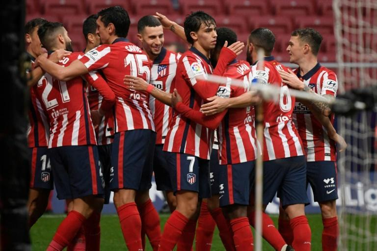 On target: Atletico Madrid's players celebrate their second goal scored by Luis Suarez