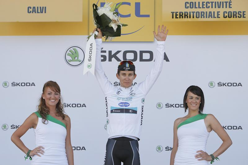 Michal Kwiatkowski of Poland, wearing the best young rider's white jersey, celebrates on the podium of the third stage of the Tour de France cycling race over 145.5 kilometers (91 miles) with start in Ajaccio and finish in Calvi, Corsica island, France, Monday July 1, 2013. (AP Photo/Laurent Rebours)
