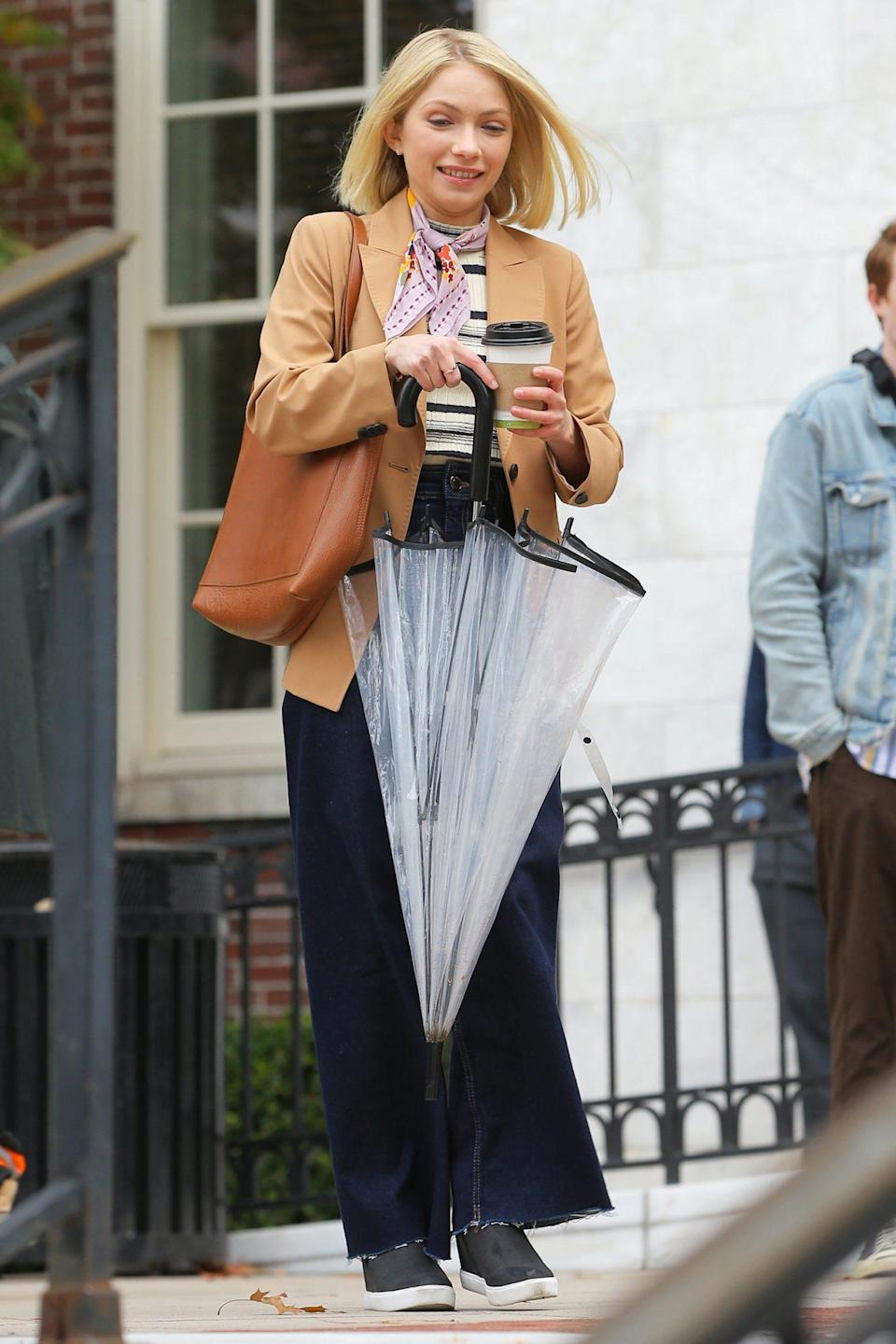 <p>Tevi Gevinson combats the cold weather by warming up with a drink as she films <em>Gossip Girl</em> at the Museum of the City of New York on Monday in N.Y.C.</p>