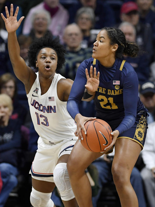 Notre Dame's Anaya Peoples, right, is pressured by Connecticut's Christyn Williams in the first half of an NCAA college basketball game, Sunday, Dec. 8, 2019, in Storrs, Conn. (AP Photo/Jessica Hill)