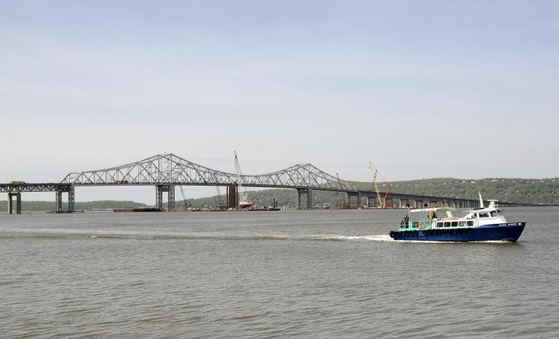 A boat ferries construction workers to and from the construction site of a new bridge to replace the 58-year-old Tappan Zee Bridge spanning the Hudson River, Tuesday, May 13, 2014, between Tarrytown and Nyack, N.Y. On Wednesday, President Barack Obama plans to speak by the bridge just north of New York City to press his case that a key federal government fund used to pay for the nation's roads, bridges and ports is running dry and that the economy would be damaged if it is not replenished. (AP Photo/Julie Jacobson)