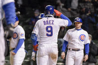 Chicago Cubs Javier Baez (9) celebrates his grand slam home run against the New York Mets during the sixth inning of a baseball game Wednesday, April 21, 2021, in Chicago. (AP Photo/Mark Black)