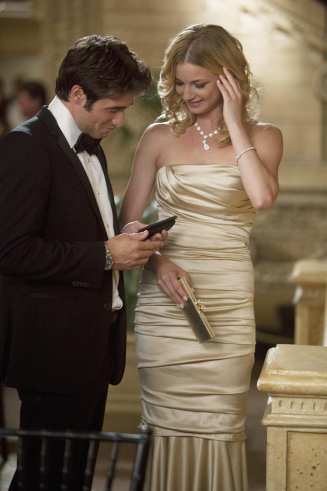 "<p class=""MsoNormal""><b>Emily Thorne's Gold Dolce & Gabbana Dress in Episode 5, 'Guilt'</b><b><span></span></b></p><p class=""MsoNormal"">Emily Thorne (Emily VanCamp) was the belle of the Open Arms charity ball in this stunning strapless gown in ruched gold satin. You'd never guess that she was sporting an orange jumpsuit and a <a href=""http://www.wetpaint.com/revenge/articles/does-revenges-emily-thorne-look-better-as-a-blonde-or-brunette""><span style=""color:#1155CC;"">hideous</span></a><a href=""http://www.wetpaint.com/revenge/articles/does-revenges-emily-thorne-look-better-as-a-blonde-or-brunette""><span style=""color:#1155CC;""> </span></a><a href=""http://www.wetpaint.com/revenge/articles/does-revenges-emily-thorne-look-better-as-a-blonde-or-brunette""><span style=""color:#1155CC;"">brown</span></a><a href=""http://www.wetpaint.com/revenge/articles/does-revenges-emily-thorne-look-better-as-a-blonde-or-brunette""><span style=""color:#1155CC;""> </span></a><a href=""http://www.wetpaint.com/revenge/articles/does-revenges-emily-thorne-look-better-as-a-blonde-or-brunette""><span style=""color:#1155CC;"">wig</span></a> just a few years earlier. And they say money can't buy you class!   </p>"