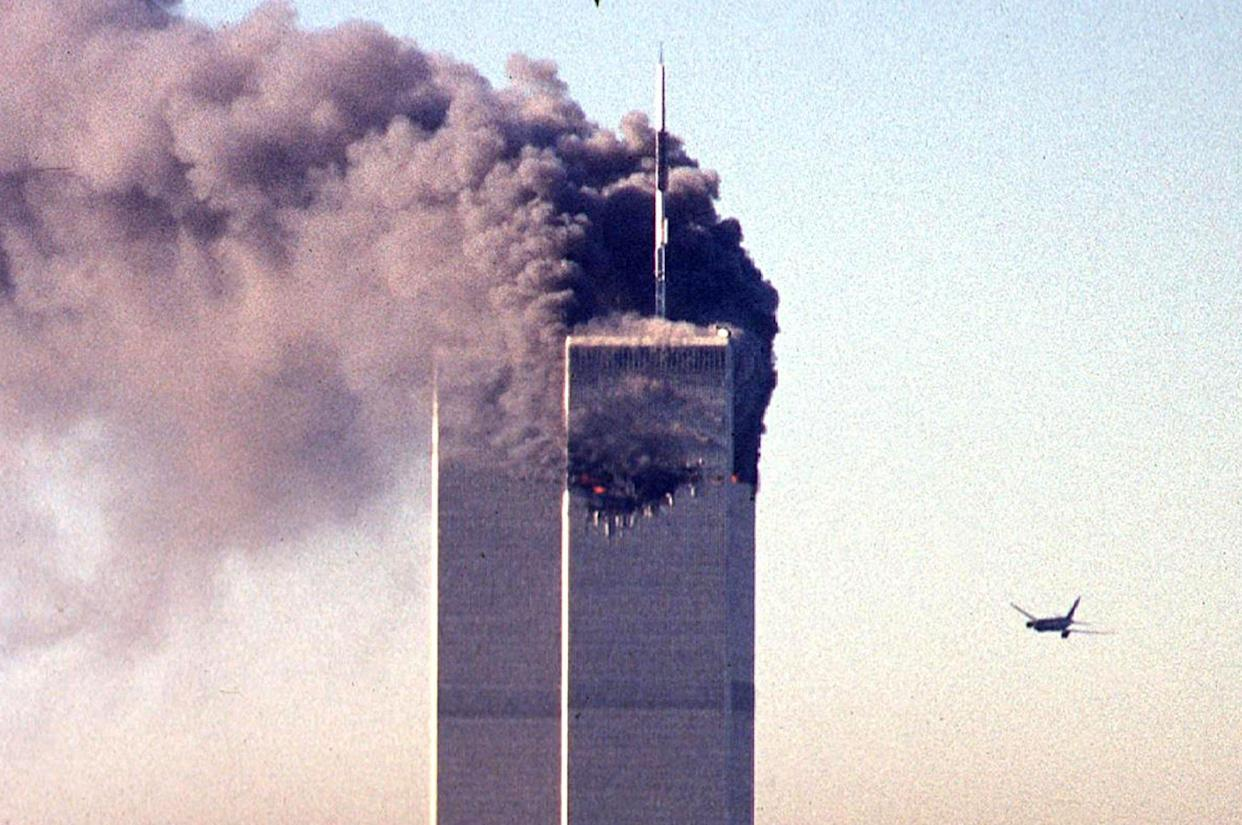 (FILES) In this file photo taken on September 11, 2001, a hijacked commercial aircraft approaches the twin towers of the World Trade Center shortly before crashing into the landmark skyscraper in New York. The remains of two more victims of 9/11 have been identified, thanks to advanced DNA technology, New York officials announced on September 8, 2021, just days before the 20th anniversary of the attacks. The office of the city's chief medical examiner said it had formally identified the 1,646th and 1,647th victim of the al-Qaeda attacks on New York's Twin Towers which killed 2,753 people. They are the first identifications of victims from the collapse of the World Trade Center since October 2019. / AFP / SETH MCALLISTER