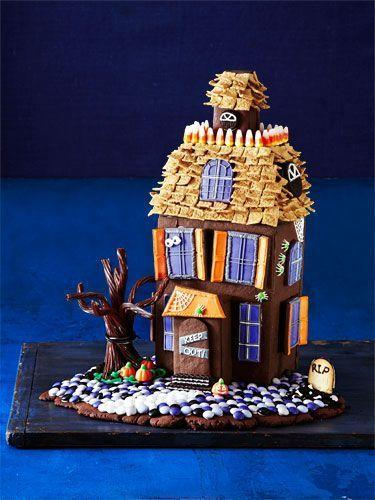 """<p>Decorate this haunted cookie mansion with candy corn and Golden Graham cereal. </p><p><strong><em><a href=""""https://www.womansday.com/food-recipes/food-drinks/g1658/halloween-haunted-cookie-house/"""" rel=""""nofollow noopener"""" target=""""_blank"""" data-ylk=""""slk:Get the Home, Scary Home recipe."""" class=""""link rapid-noclick-resp"""">Get the Home, Scary Home recipe. </a></em></strong></p>"""
