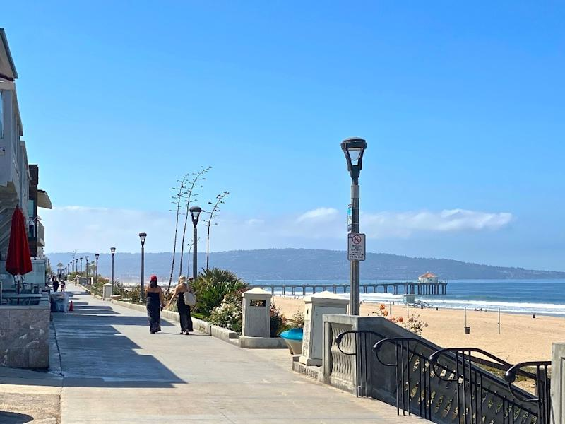 The Strand is a popular beachside walkway with stunning views of the ocean and Manhattan Beach Pier.