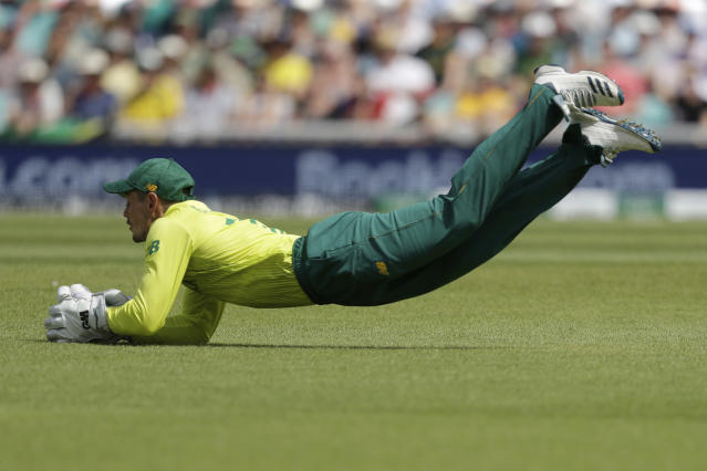 South Africa's Quinton de Koc catches out Bangladesh's Soumya Sarkar during the Cricket World Cup match between South Africa and Bangladesh at the Oval in London, Sunday, June 2, 2019. (AP Photo/Matt Dunham)