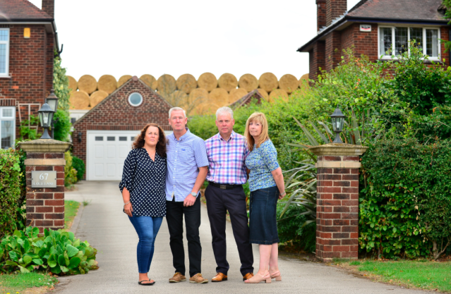 <em>Homeowners in Ockbrook are furious with the giant wall of hay behind their properties (SWNS)</em>