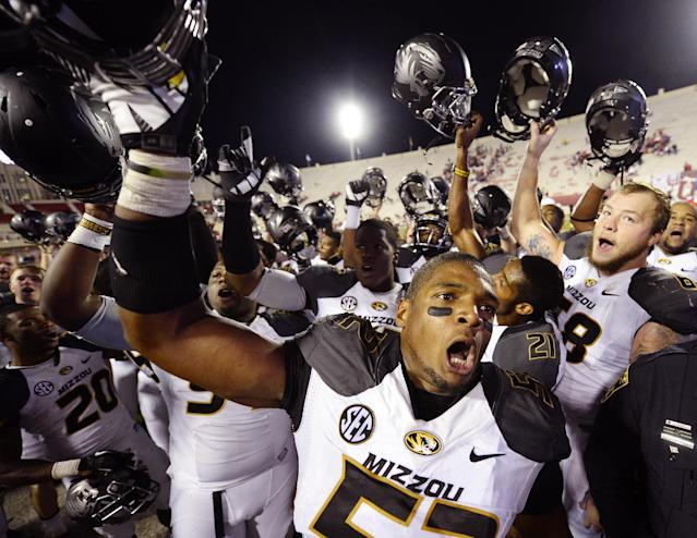 Missouri Tigers defensive lineman Michael Sam (52) reacts after the game at Memorial Stadium after Missouri defeated Indiana 45-28 in Bloomington, Indiana in this file photo from September 21, 2013. According to media reports, Sam, who was the Southeastern Conference defense player of the year, announced publicly he was gay February 9, 2014, paving the way from him to perhaps be the NFL's first openly gay player. Mandatory Credit: Denny Medley-USA TODAY Sports (UNITED STATES)