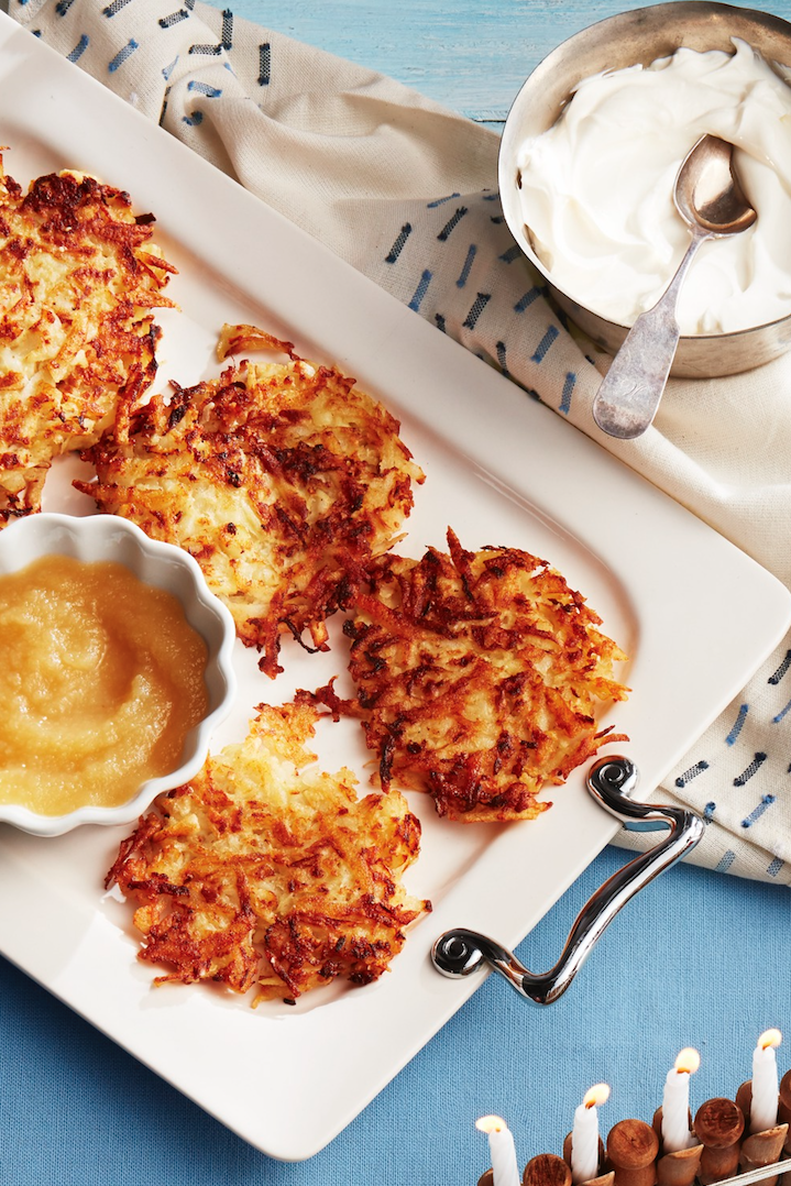"""<p>Hanukkah and Christmas overlap this year, so if guests of mixed faith are attending your celebration, why not whip up these crispy latkes? In this updated potato pancakes recipe, parsnips add to the depth and flavor of the final result. </p><p><strong><a href=""""https://www.countryliving.com/food-drinks/a29638895/potato-and-parsnip-latkes-recipe/"""" rel=""""nofollow noopener"""" target=""""_blank"""" data-ylk=""""slk:Get the recipe"""" class=""""link rapid-noclick-resp"""">Get the recipe</a>.</strong> </p>"""