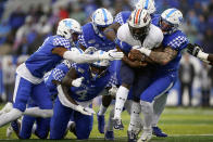 UT Martin running back Jaimiee Bowe (5) is tackled by a group of Kentucky defenders in the first half of an NCAA college football game against UT Martin, Saturday, Nov. 23, 2019, in Lexington, Ky. (AP Photo/Bryan Woolston)