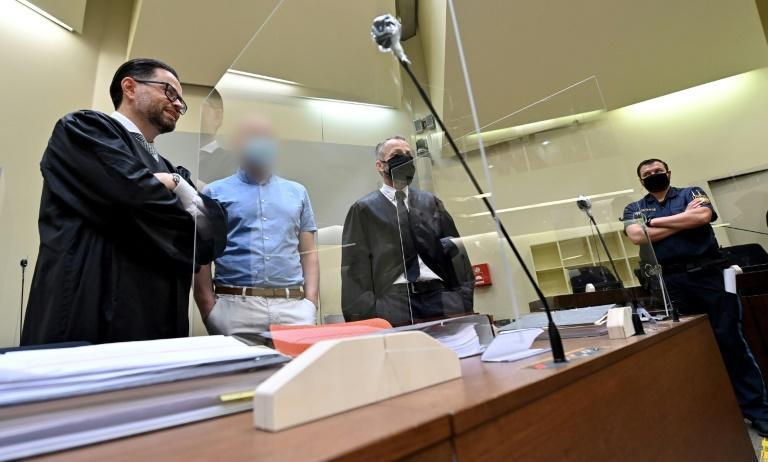 German sports physician Mark Schmidt (2ndL) appears in court in Munich on Wednesday