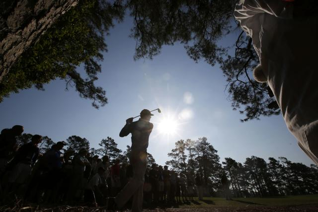 U.S. golfer Matt Kuchar hits a shot on the second hole during the second round of the Masters golf tournament at the Augusta National Golf Club in Augusta, Georgia April 11, 2014. REUTERS/Jim Young (UNITED STATES - Tags: SPORT GOLF)