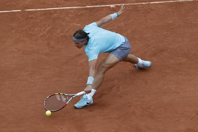 Spain's Rafael Nadal returns the ball during the first round match of the French Open tennis tournament against Robby Ginepri of the U.S. at the Roland Garros stadium, in Paris, France, Monday, May 26, 2014. (AP Photo/Michel Euler)