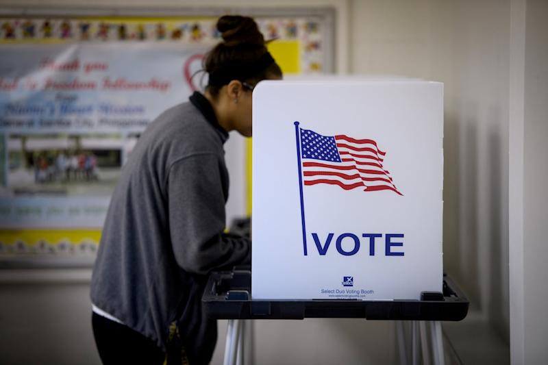 CAMBRIDGE, OH - NOVEMBER 06: A woman casts her votes the Called to Freedom Fellowship Church polling location on Election Day on November 6, 2018 in Cambridge, Ohio. Turnout is expected to be high nationwide as Democrats hope to take back control of at least one chamber of Congress. (Photo by Justin Merriman/Getty Images)