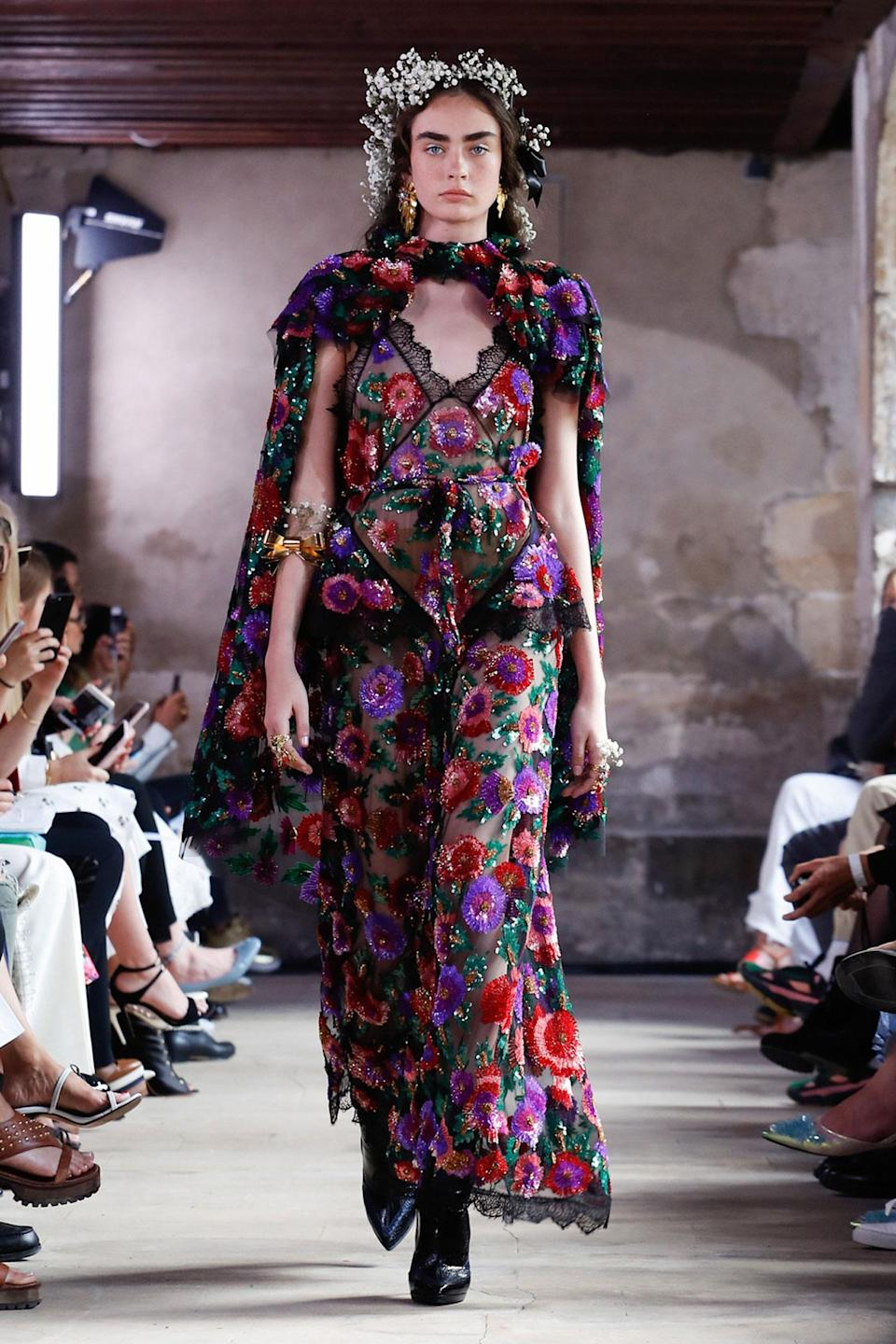 <p>Dark floral velvet dress with cape from the SS18 Rodarte collection. (Photo: ImaxTree) </p>