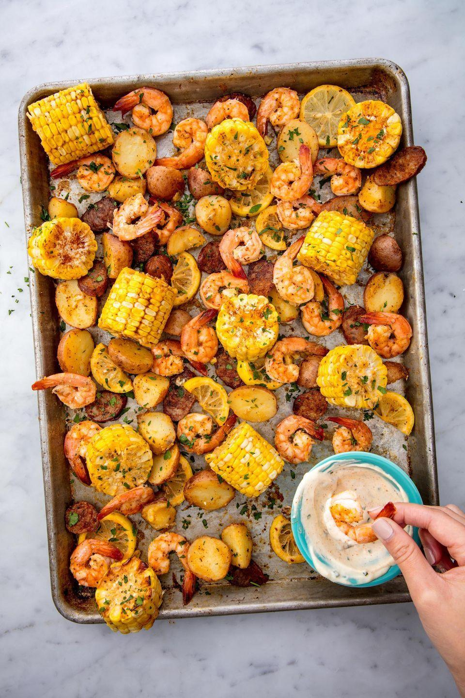 """<p>A mix of shrimp, andouille sausage, corn, and potatoes, this Cajun summer favorite is the super satisfying.</p><p>Get the recipe from <a href=""""https://www.delish.com/cooking/recipe-ideas/recipes/a53582/sheet-pan-shrimp-boil-recipe/"""" rel=""""nofollow noopener"""" target=""""_blank"""" data-ylk=""""slk:Delish"""" class=""""link rapid-noclick-resp"""">Delish</a>.</p>"""
