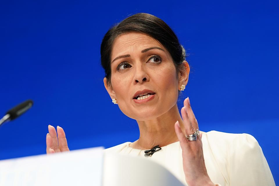 MANCHESTER, ENGLAND - OCTOBER 05: Priti Patel, Secretary of State for the Home Department delivers her keynote speech during the Conservative Party Conference at Manchester Central Convention Complex on October 05, 2021 in Manchester, England. This year's Conservative Party Conference returns as a hybrid of in-person and online events after last year it was changed to a virtual event due to the Coronavirus pandemic. Boris Johnson addresses the party as its leader for the third time.  (Photo by Ian Forsyth/Getty Images)