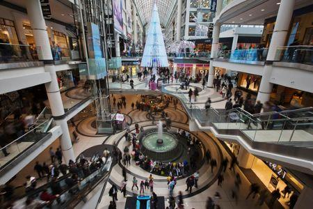 FILE PHOTO: People go shopping in the Eaton Centre shopping mall as they walk by a giant Christmas Tree in Toronto