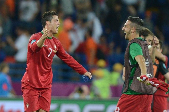 Portuguese forward Cristiano Ronaldo (L) celebrates after winning the Euro 2012 football championships match Portugal vs. Netherlands on June 17, 2012 at the Metalist stadium in Kharkiv.   AFP PHOTO / PATRICK HERTZOGPATRICK HERTZOG/AFP/GettyImages