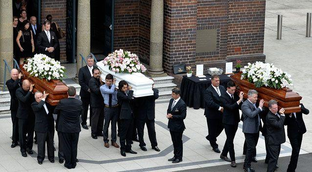 Three caskets were carried into St Mary's Catholic Church in Concord on Wednesday morning. Photo: AAP