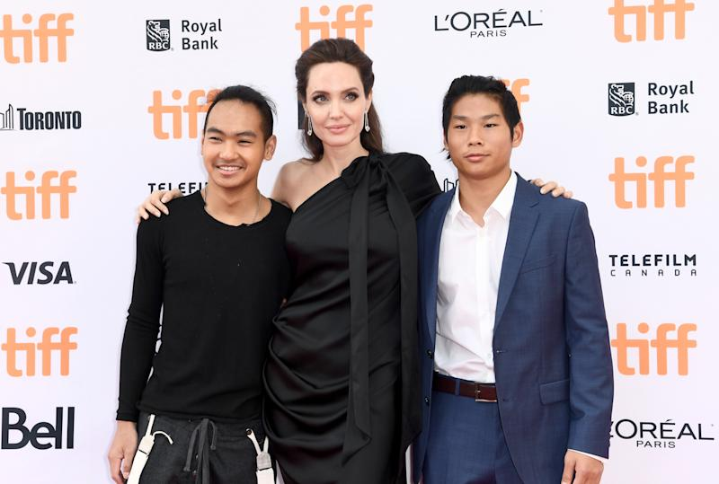 Angelina Jolie pictured with sons Maddox (L) and Pax (R) in 2017. Photo: Getty