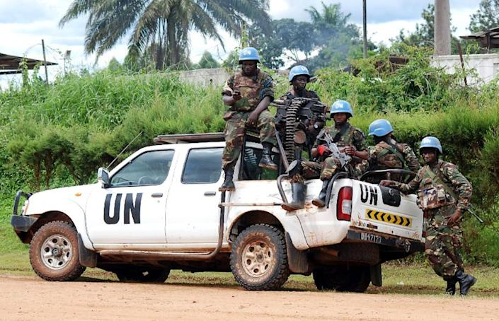Blue helmet members of the United Nations Organization Stabilization Mission in the Democratic Republic of Congo, MONUSCO, have been in the country since 1999 (AFP Photo/ALAIN WANDIMOYI)