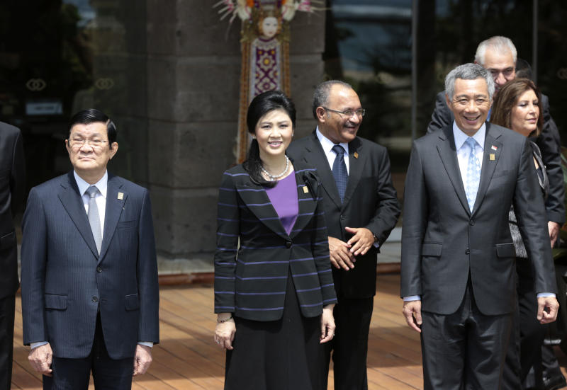From left, Hong Kong Chief Executive Leung Chun-ying, Thai Prime Minister Yingluck Shinawatra, Papua New Guinean Prime Minister Peter O'Neill, Singapore's Prime Minister Lee Hsien Loong stand for a group photo session for the leaders of the Asia-Pacific Economic Cooperation (APEC) forum in Bali, Indonesia, Tuesday, Oct. 8, 2013. (AP Photo/Dita Alangkara)