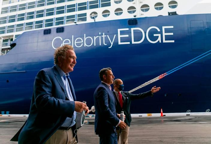 Richard Fain, Chairman and CEO of Royal Caribbean Group, far-left, and Brian Abel, Senior Vice President of Hotel Operations with Celebrity Cruises, center, make their way to the front of Royal Caribbean's Celebrity Edge cruise ship docked at Port Everglades in Fort Lauderdale, Florida on Saturday, June 26, 2021. After departing Port Everglades Saturday, Royal Caribbean's Celebrity Edge will be the first cruise ship sailing with guests from a U.S. port in over 15 months.