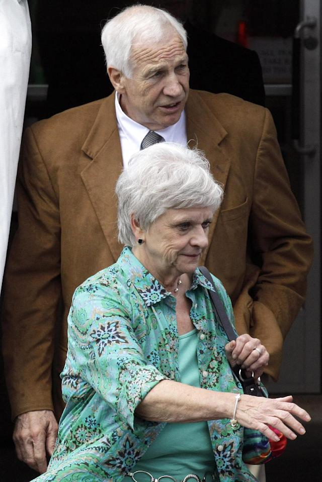 Former Penn State University assistant football coach Jerry Sandusky, rear, and his wife Dottie leave the Centre County Courthouse in Bellefonte, Pa., Friday, June 22, 2012. Sandusky is accused of sexually abusing 10 boys over a 15-year period. (AP Photo/Gene J. Puskar)