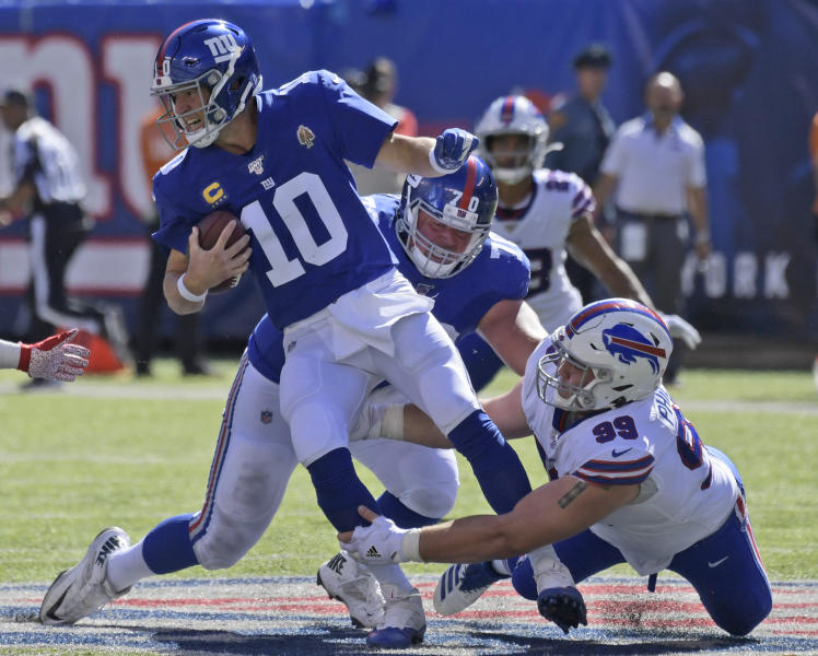 New York Giants quarterback Eli Manning (10) fumbles the ball as he is tackled behind the line of scrimmage during the second half of an NFL football game against the Buffalo Bills, Sunday, Sept. 15, 2019, in East Rutherford, N.J. (AP Photo/Bill Kostroun)