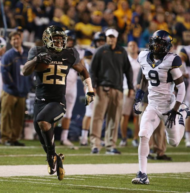 Baylor running back Lache Seastrunk (25) scores past West Virginia safety K.J. Dillon (9), right, during the first half of an NCAA college football game on Saturday, Oct. 5, 2013, in Waco, Texas. (AP Photo/Rod Aydelotte)