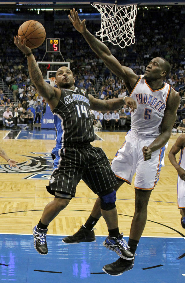 Orlando Magic's Jameer Nelson (14) shoots against Oklahoma City Thunder's Kendrick Perkins (5) during the first half of an NBA basketball game Thursday, March 1, 2012, in Orlando, Fla. (AP Photo/John Raoux)