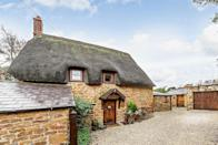 "<p>In the heart of Banbury, Oxfordshire, this charming thatched Grade II Listed cottage ticks all the right boxes. Some of the standout features include vaulted ceilings, period style bathrooms, underfloor heating, and an inglenook fireplace. When can we move in? </p><p><a href=""https://www.zoopla.co.uk/for-sale/details/57482340"" rel=""nofollow noopener"" target=""_blank"" data-ylk=""slk:This property is currently on the market for £440,000 with Fine & Country via Zoopla"" class=""link rapid-noclick-resp"">This property is currently on the market for £440,000 with Fine & Country via Zoopla</a>. </p>"