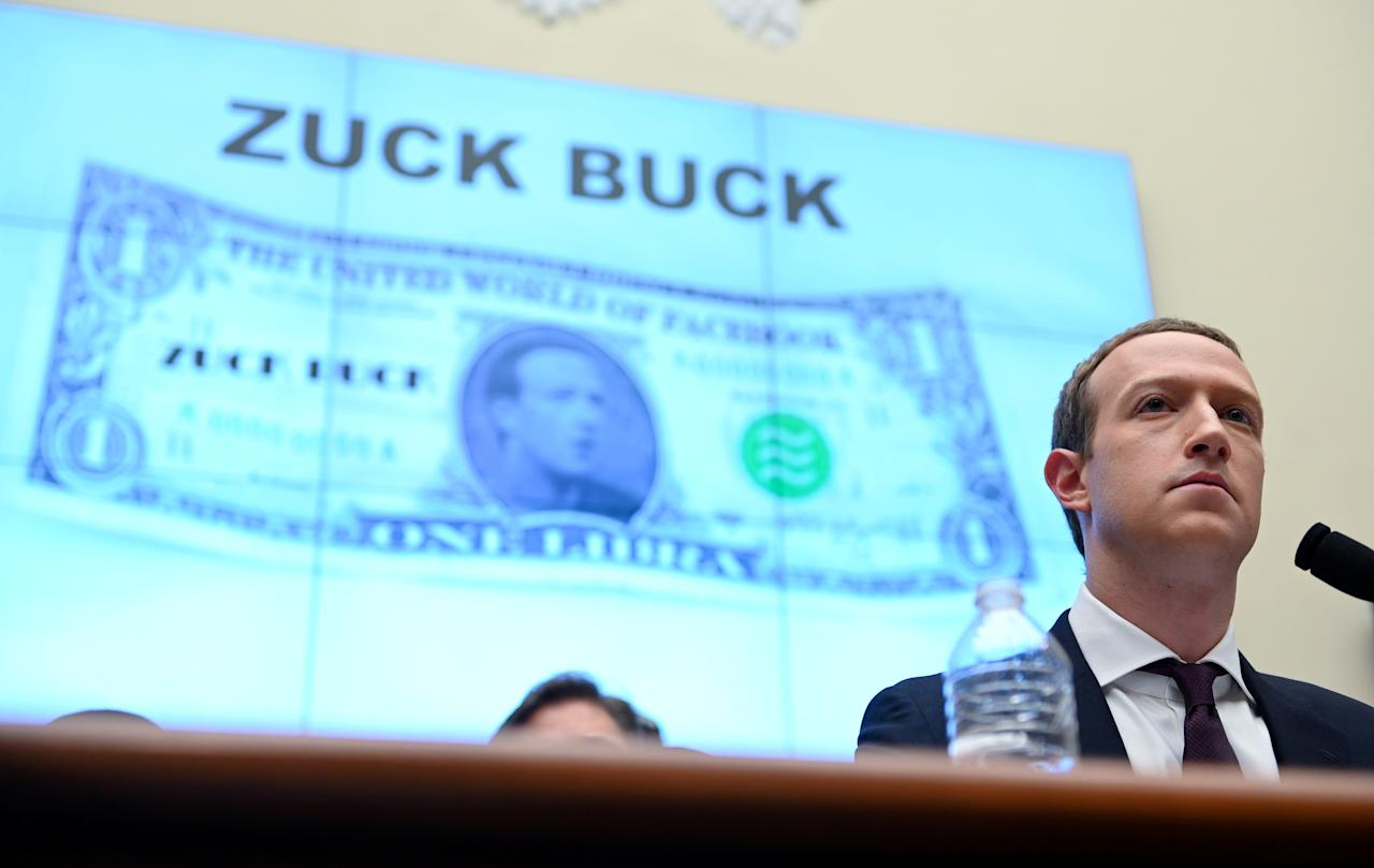 "Facebook Chairman and CEO Mark Zuckerberg testifies in front of a projection of a ""Zuck Buck"" at a House Financial Services Committee hearing examining the company's plan to launch a digital currency on Capitol Hill in Washington, U.S., October 23, 2019. REUTERS/Erin Scott     TPX IMAGES OF THE DAY"