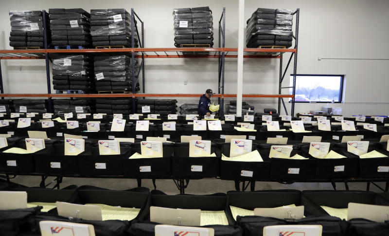 CORRECTS TO BEXAR COUNTY, NOT BEAR - Workers prepare election day kits at the Bexar County Election offices, Tuesday, Feb. 13, 2018, in San Antonio. The first primaries of the 2018 elections are less than a month away, but efforts to safeguard the vote against expected Russian interference are lagging. (AP Photo/Eric Gay)