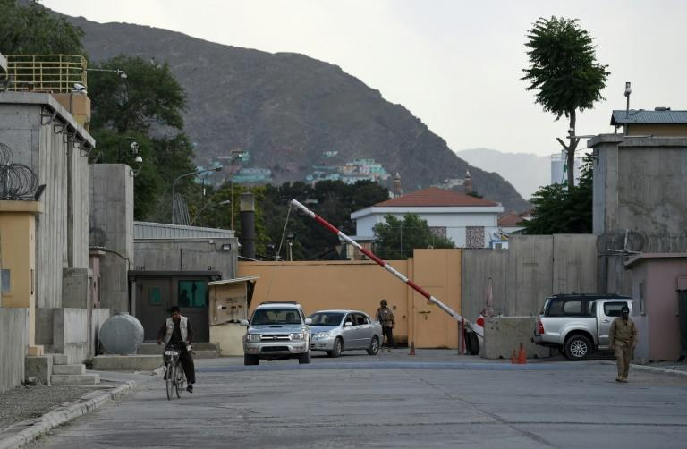 A labyrinth of concrete blast walls, spotlights, and checkpoints are eating up ever more of Kabul, standing in stark contrast to a similar area in Iraq's Baghdad where easing tensions have seen its barricades come down (AFP Photo/WAKIL KOHSAR)