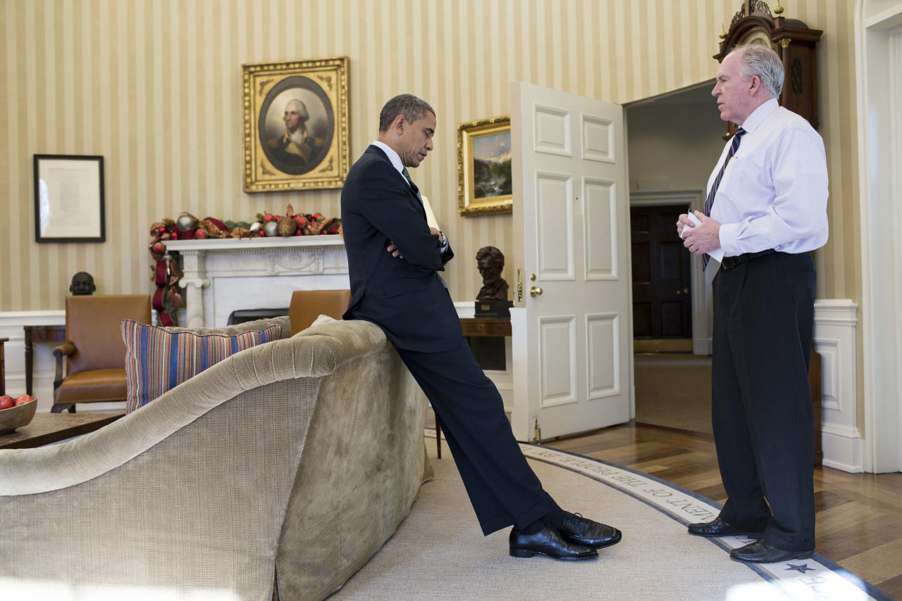 "President Barack Obama reacts as Counterterrorism chief and adviser John Brennan briefs him at the White House on the details of the shootings at Sandy Hook Elementary School in Newtown, Connecticut, December 14, 2012, in this White House handout photo released January 4, 2013. The president later said during a television interview that this was ""the worst day of his Presidency."" REUTERS/Peter Souza/Official White House Photo/Handout  (UNITED STATES - Tags: CRIME LAW POLITICS TPX IMAGES OF THE DAY) FOR EDITORIAL USE ONLY. NOT FOR SALE FOR MARKETING OR ADVERTISING CAMPAIGNS. THIS IMAGE HAS BEEN SUPPLIED BY A THIRD PARTY. IT IS DISTRIBUTED, EXACTLY AS RECEIVED BY REUTERS, AS A SERVICE TO CLIENTS"