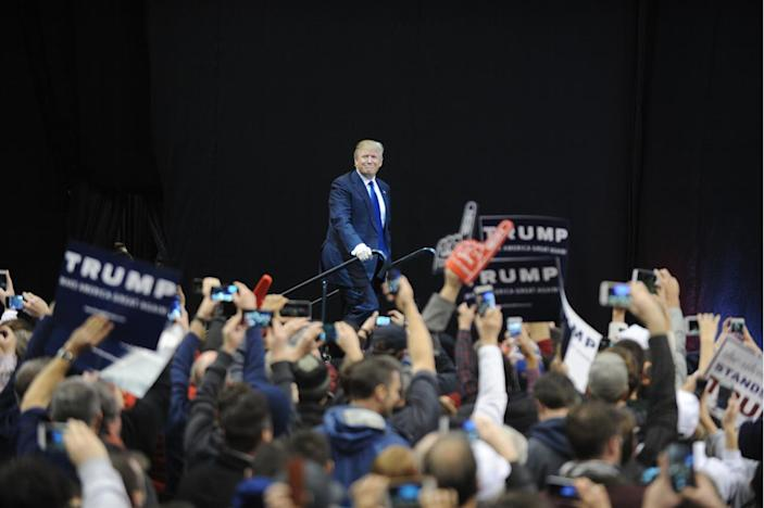 <p>Donald Trump speaks to supporters during a rally ahead of the New Hampshire Primary at the Manchester Verizon Center in Manchester, New Hampshire on February 8, 2016. <i>(Photo: Dennis Van Tine/MediaPunch/IPX/AP)</i></p>