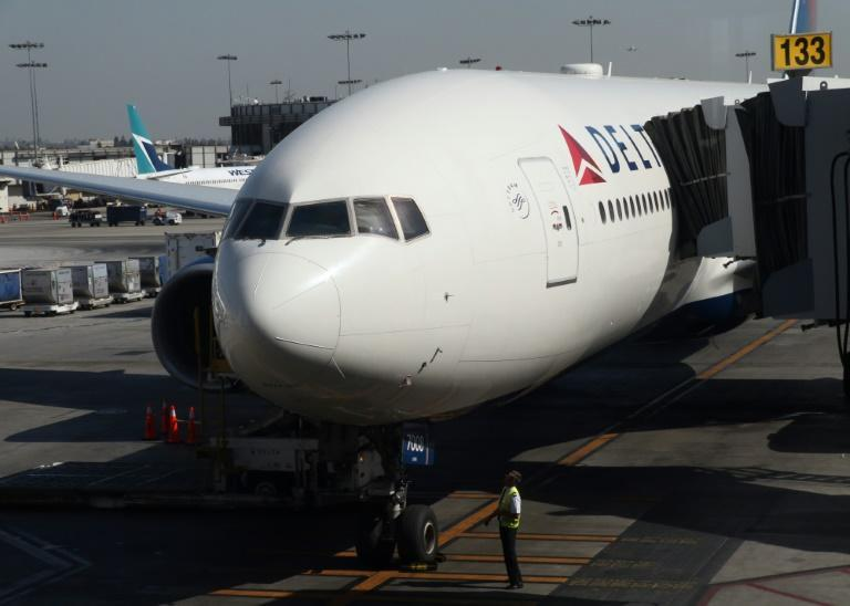The CEO of Delta Air Lines has said employees who decide not to receive a Covid vaccination will be charged an extra $200 a month for health insurance (AFP/Daniel SLIM)